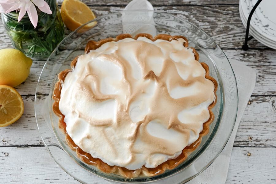 This Lemon Meringue Pie looks normal on the outside, but is hiding a rainbow on the inside.