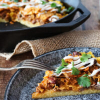 Chili Cheese Polenta; crispy-edged, creamy-centered polenta topped with chili, cheese, and crunchy crushed nacho chips. No one will ever guess that this chili cheese polenta is a frugal leftover makeover, unless you tell them that is!