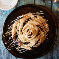 Giant Chocolate Cinnamon Rolls, The easiest. The biggest. The most delicious and giant chocolate cinnamon roll you've ever had. Loaded with melty chocolate, cinnamon, and sugar, and topped with cream cheese icing.