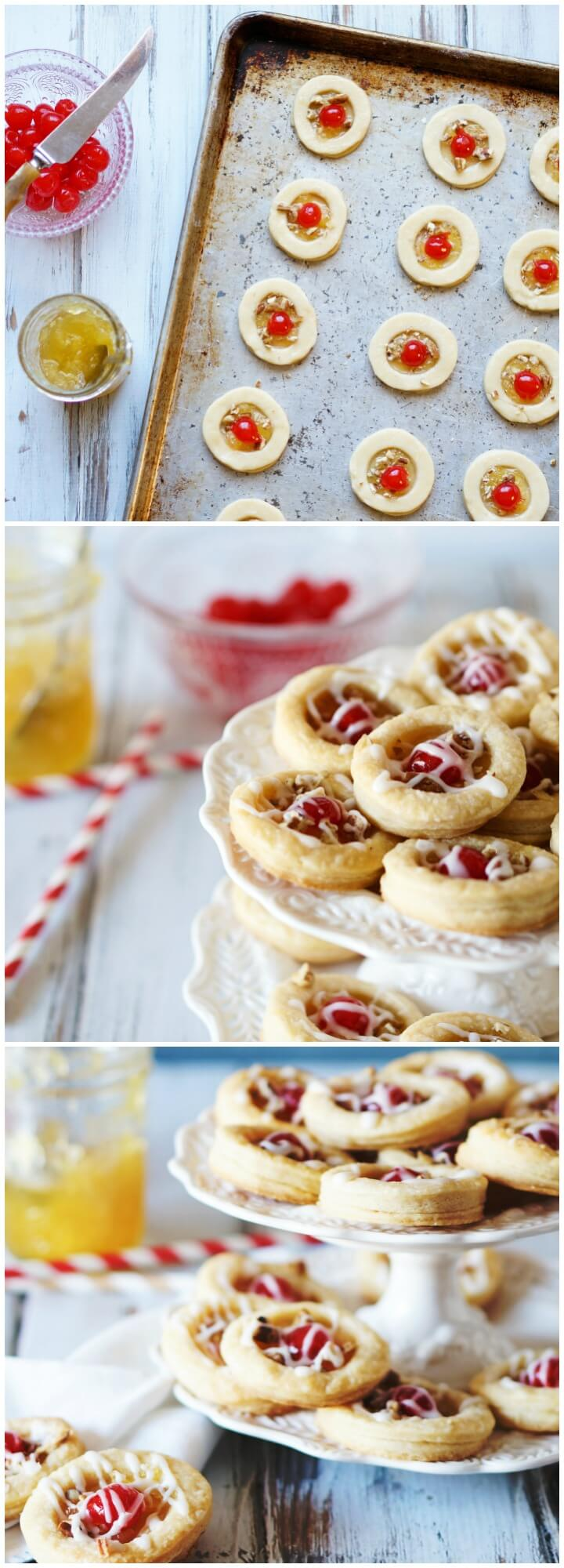 Pineapple Cookies, light flaky pastry rounds with juicy pineapple filling, topped with maraschino cherries, pecans, and powdered sugar glaze.
