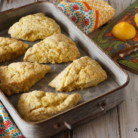 Lemon sugar scones are light and tender, with a delicate and natural lemon flavor. Perfect for nibbling alongside your favorite cup of tea. Recipe on www.accidentalhappybaker.com @AHBamy