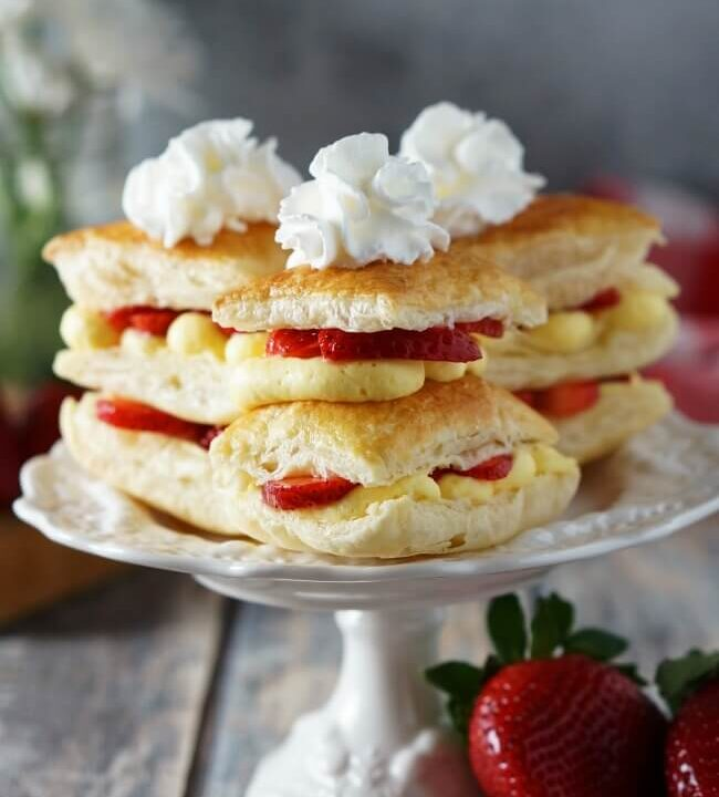 Light and fresh, but oh so indulgent, strawberry napoleons start with flaky puff pastry layered with fresh strawberries and Bavarian cream, topped off with a perfect swirl of whipped cream. Ready in 30 minutes. Recipe on www.accidentalhappybaker.com @AHBamy