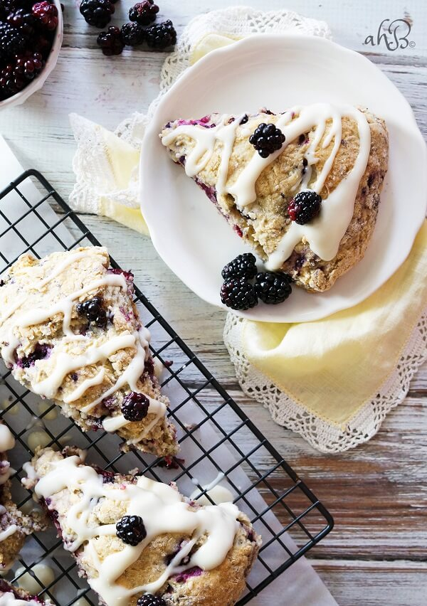 Tender and flaky scones are studded with sweet tart blackberries and topped with a rich cream cheese glaze for a winning combination.