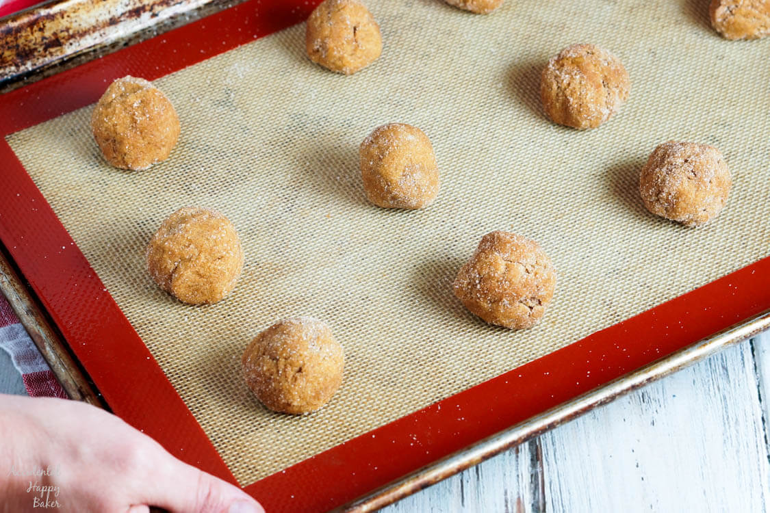 A sheet pan of pumpkin gingersnap cookies ready to go into the oven.