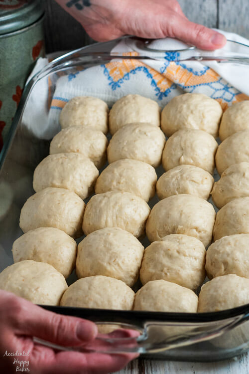 The oatmeal rolls are shaped and placed in a pan to rise again.