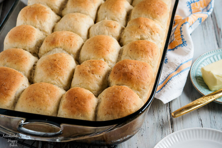 A pan of light and fluffy oatmeal rolls fresh from the oven.