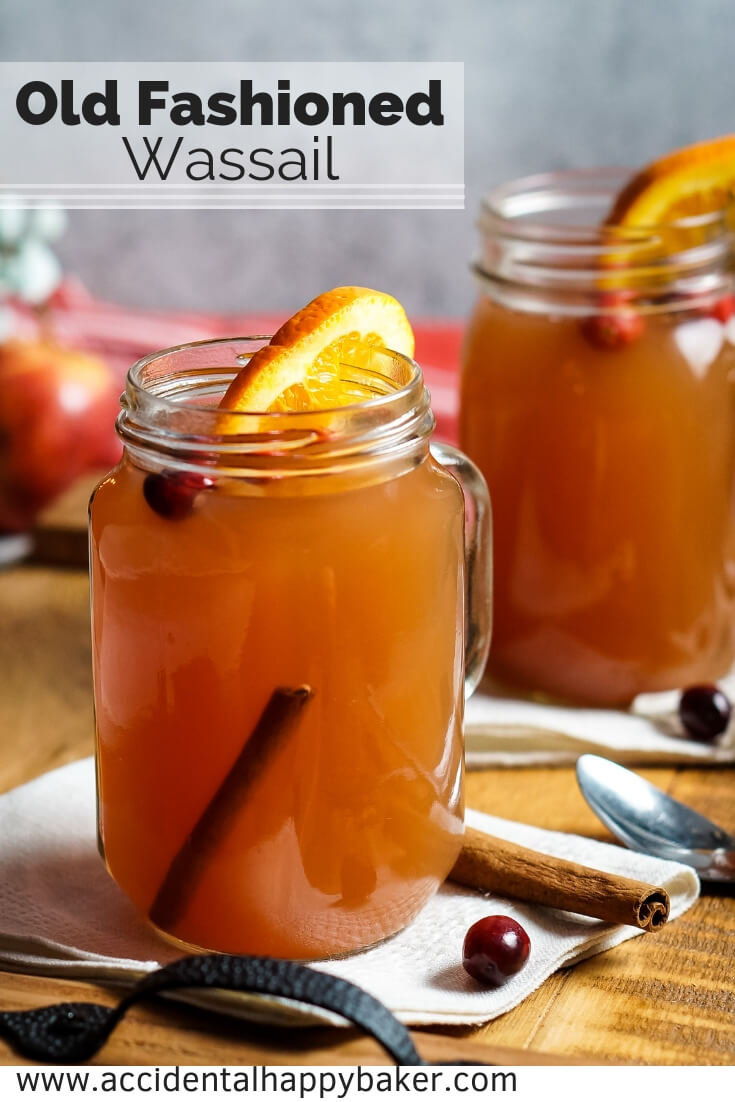 Old Fashioned Wassail takes apple juice, cranberry juice, pineapple juice, and spices and transforms them into the ultimate winter warm-you-up drink! #holidayrecipes #wassail #christmasrecipes #drinkrecipe #cider #crockpotrecipes #accidentalhappybaker