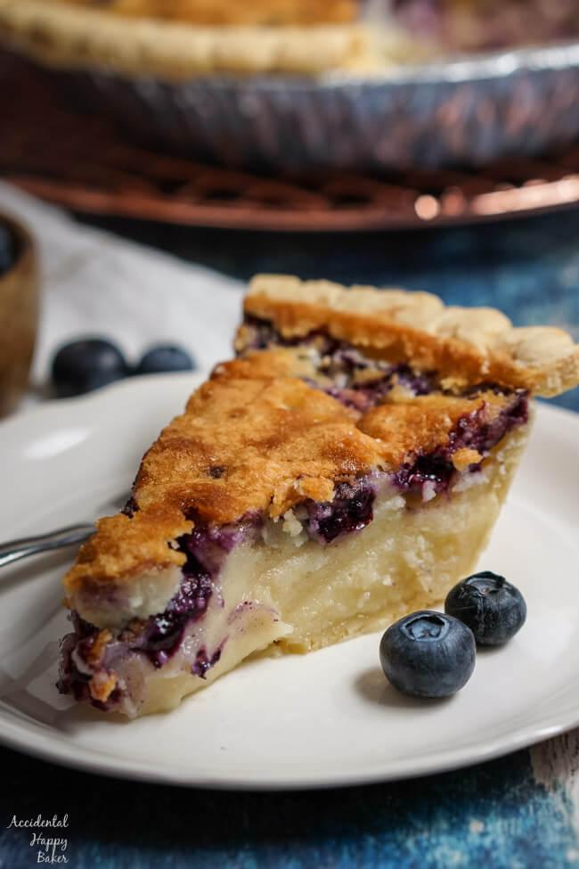 A slice of blueberry buttermilk pie.