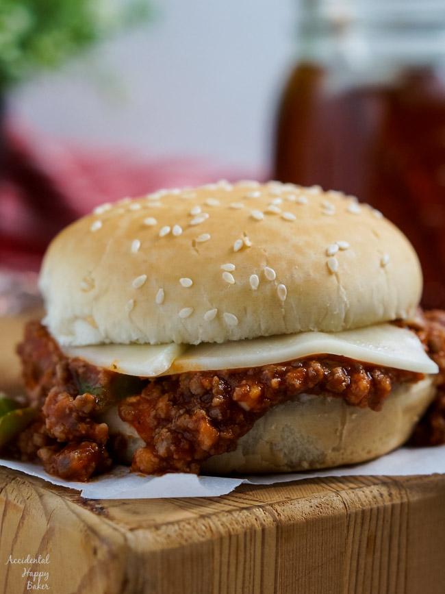 An Italian Sloppy Joe Sandwich sitting on a cutting board.