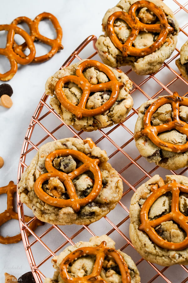 Peanut Butter Pretzel Chocolate Chip Cookies are set out on a cooling rack.