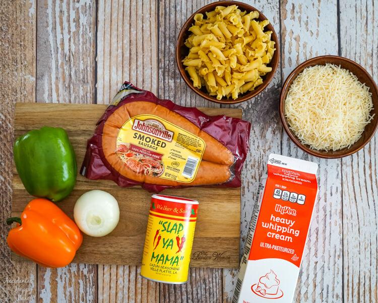 Pasta, parmesan cheese, peppers, sausage, cream, onion, and cajun seasoning