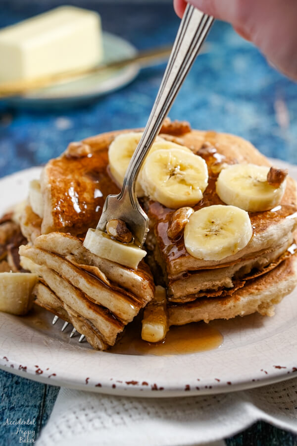 Several layers of banana pancakes speared on the end of a fork.