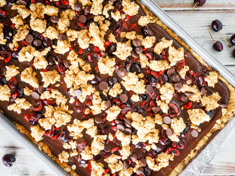 A pan of cherry revel bars ready to be put in the oven to bake.