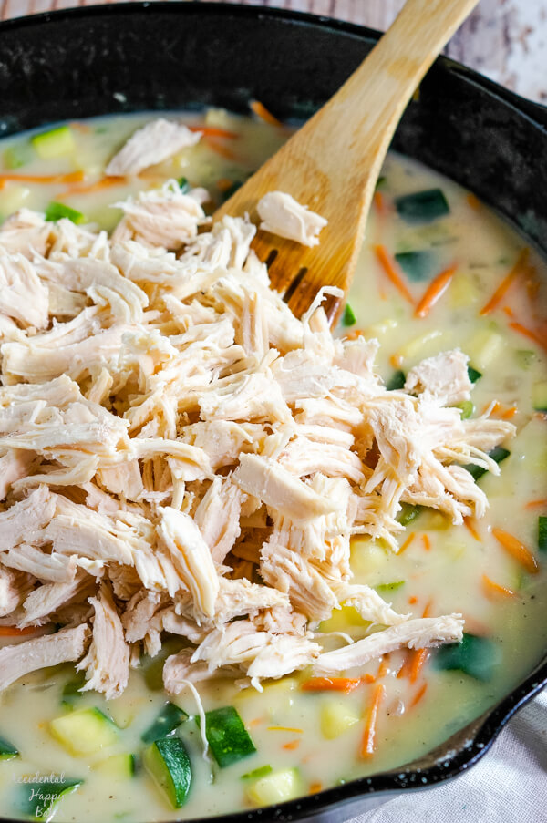 Shredded chicken is added to the skillet with the veggies and homemade cream of chicken soup.