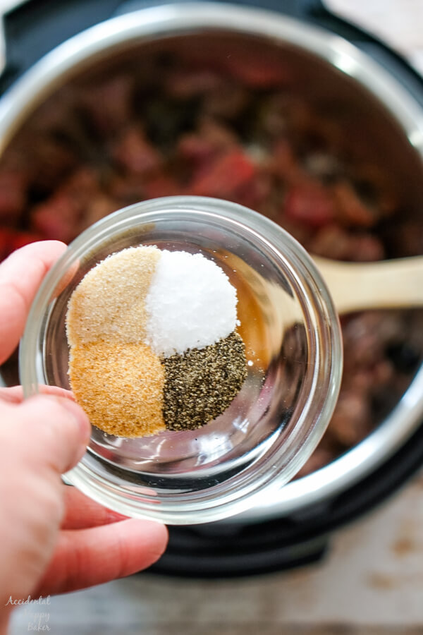 Adding the seasonings to the beef in the instant pot.