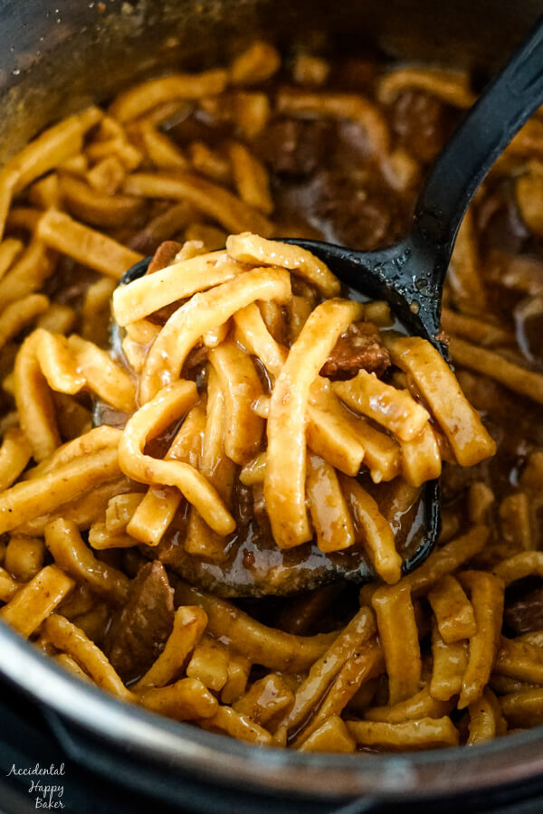 Ladling out the beef and noodles from the instant pot.