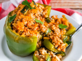 A wild rice stuffed pepper that has been cut open.