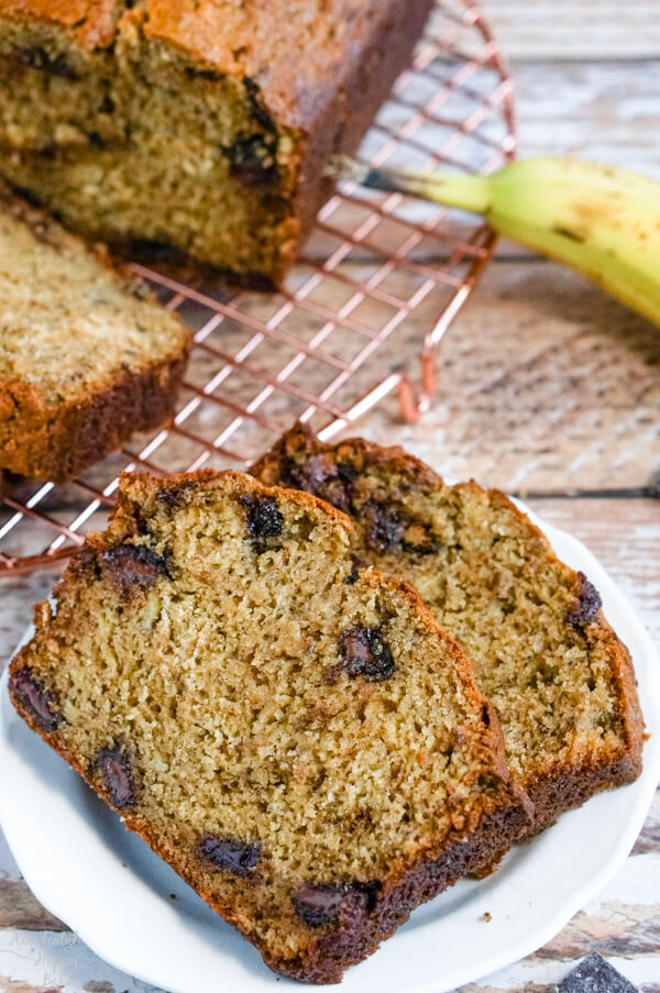 A close up of two slices of banana bread that show the chocolate chunks and the texture of the finished bread.
