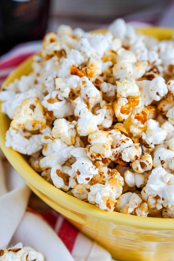 A close up of a yellow bowl full of Kettle Corn.