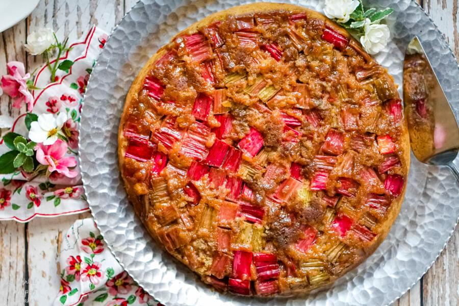 Rhubarb Ginger Upside Down Cake on a silver serving platter.