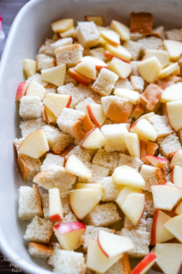 Bread cubes and chopped apples are layered in a 9x13 pan.