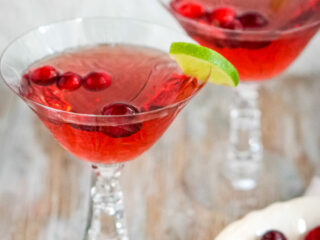 Two crystal glasses of cranberry moscato punch.