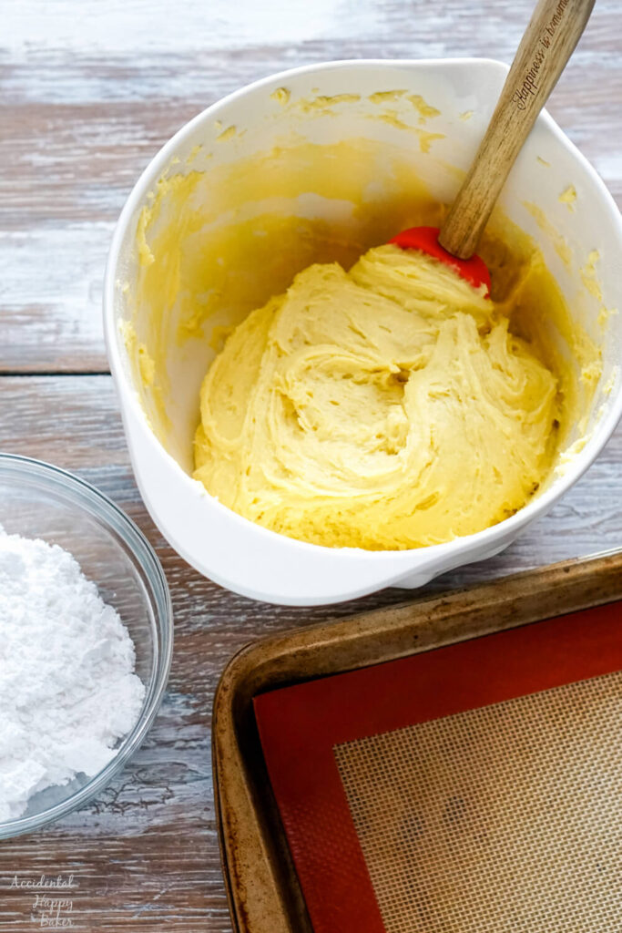 Step one is to combine the lemon cake mix with the butter and eggs.