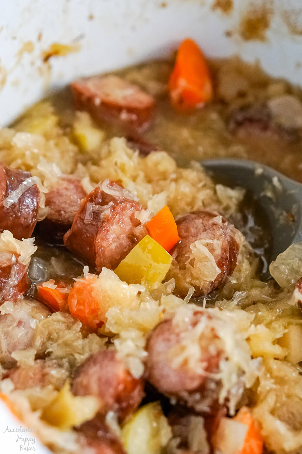 A close up image of the finished kielbasa and sauerkraut after it has finished cooking.