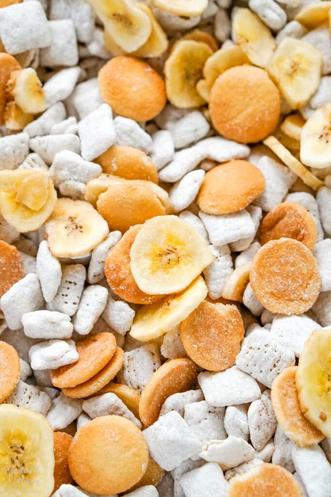 Banana Cream Pie Muddy Buddies Mix,  banana chips, mini vanilla wafer cookies and banana cream pie flavored cereal pieces.