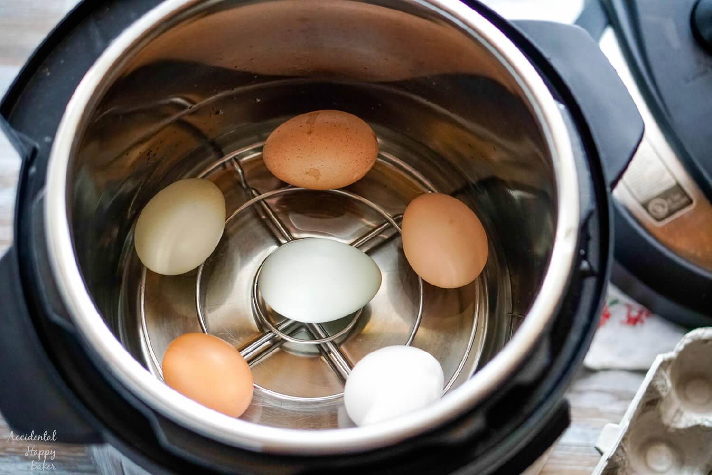 Eggs on a rack inside an instant pot.