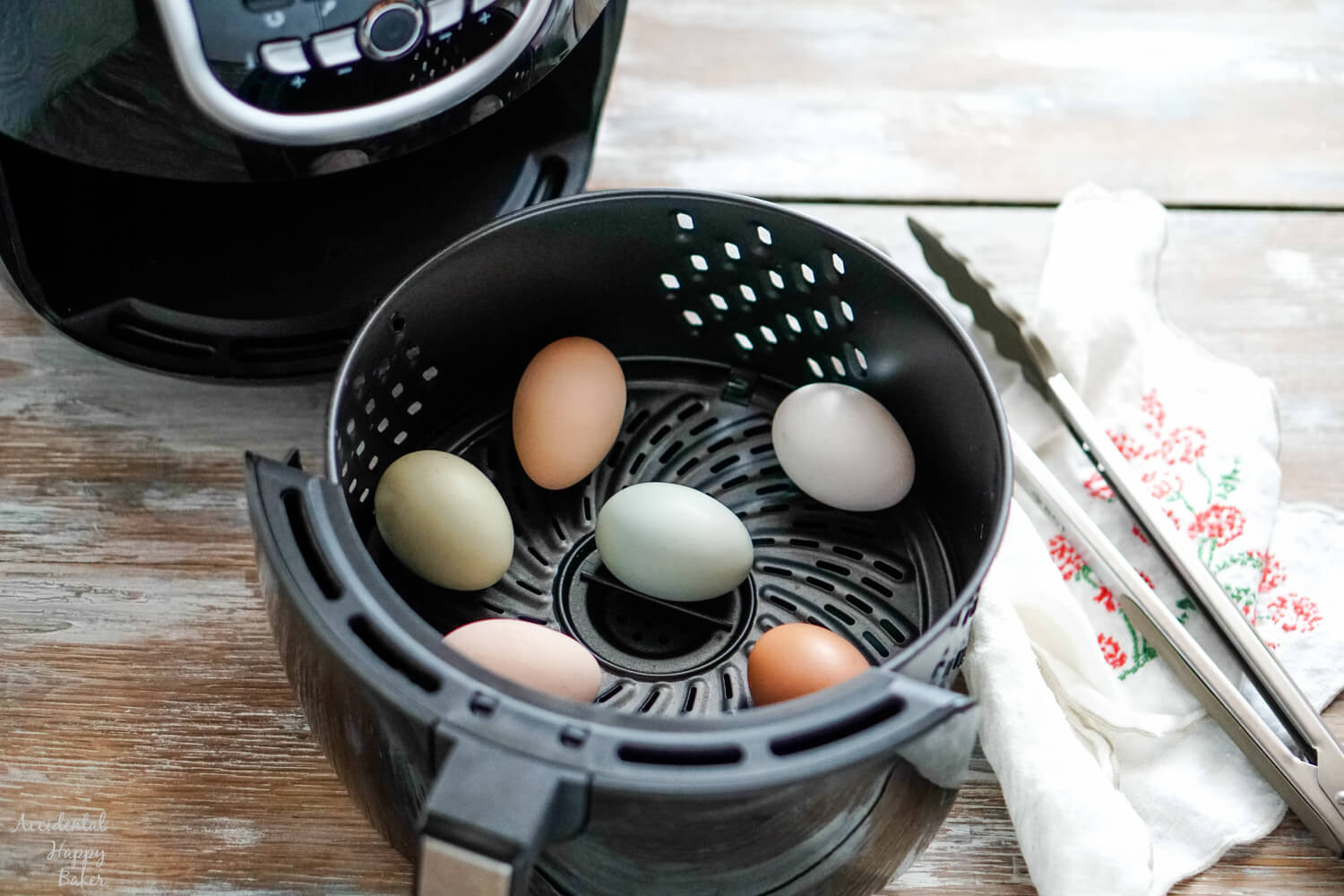 Several eggs in the basket of an air fryer.