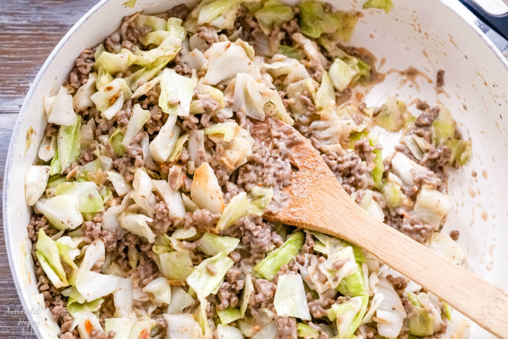 A skillet full of the ground beef and cabbage filling for the Runza casserole.