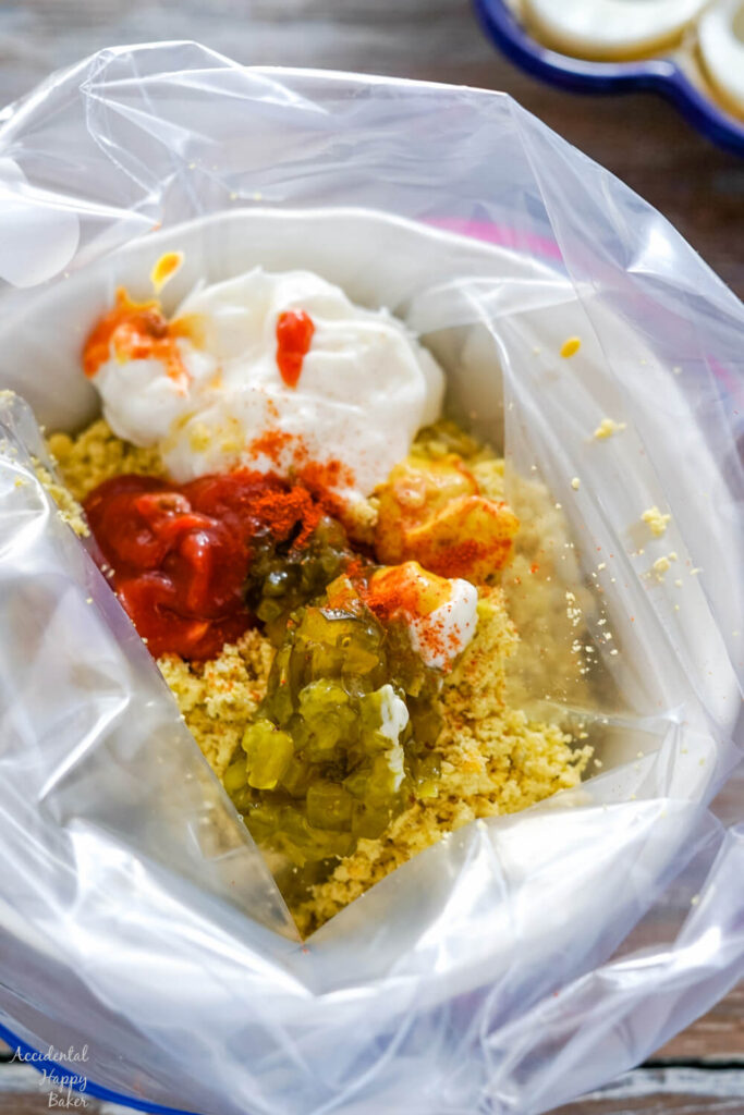 The ingredients for spicy deviled egg filling in a ziploc bag, ready to be combined.